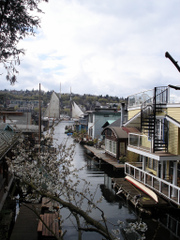 Schooner framed between houseboats, Lake Union